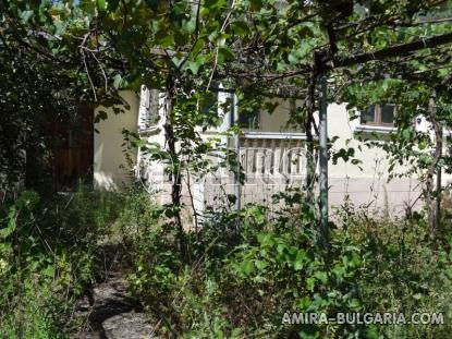 Old bulgarian house in a well served village garden